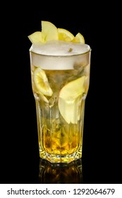 Cocktail with beer, calvados, apple syryp with ice cubes decorated with slices of lemon and apple