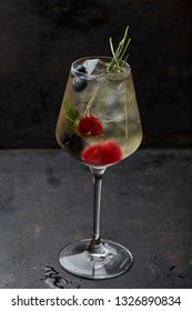 cocktail with berries and lemongrass