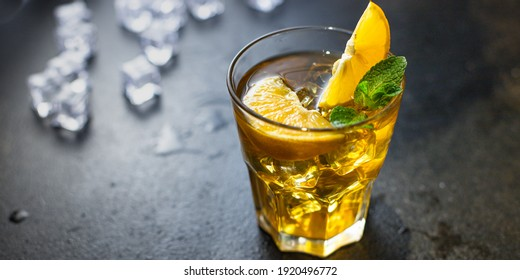 cocktail beverage alcoholic drink transparent glass ice cube lemon mint portion on the table meal outdoor top view copy space for text food background rustic