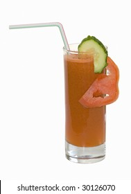 Cocktail from carrots juice with a slice of a tomato and a cucumber