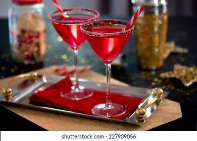 Cocktail for Christmas: Vodka infused with candy cane and glass rimmed with chocolate and crushed candy cane. Great for entertaining!