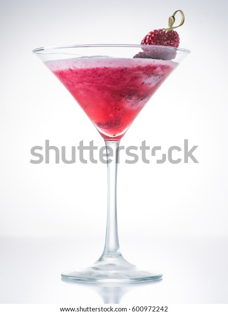 Cocktail clover club with raspberries on a light background