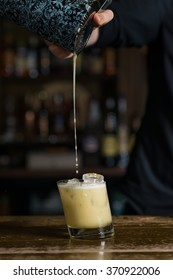 Cocktail with coffee cream and exotic flowers