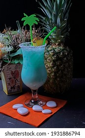 Cocktail with cream vodka Blue Curacao coconut syrup crush ice and pineapple juice. tasty and fruity cocktails served in glasses
