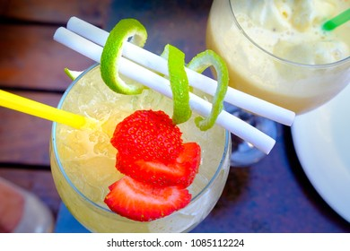 Cocktail decorated with ice, fruits, ice cream