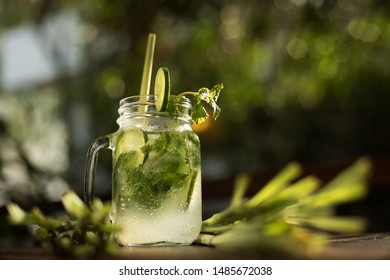 Cocktail drink with environmentally friendly straw made with lemongrass