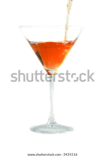 The cocktail flowing into a glass. Isolation on white