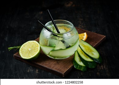 Cocktail Gin with Cucumber. Alcoholic cocktail. On a wooden background. Top view. Free copy space.