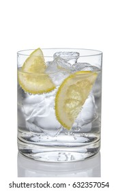 Cocktail gin and tonic with lemon and ice isolated on white.