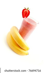 cocktail glass of banana strawberry smoothie with fresh fruits