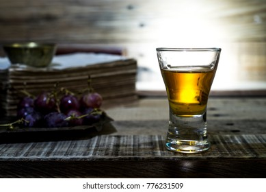 Cocktail Glass with brandy or whiskey - Small Shot. on wooden background
