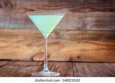 Cocktail glass of classic daiquiri on the wooden background