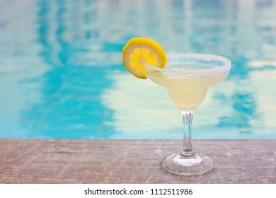 Cocktail glass on outdoor poolside. Margarita