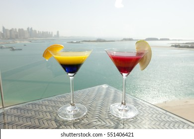 cocktail glass on table with sea background