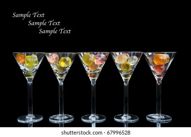 Cocktail glasses with colorful fruit gelatine - studio shooting with intended low-key tone, isolated for copy-space