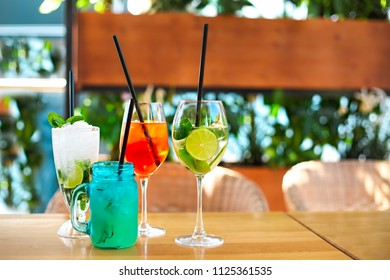 Cocktail glasses on wooden table outdoor