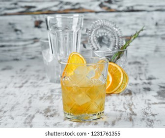 Cocktail Godfather. Whiskey and Almond Liquor. Alcoholic cocktail in a glass. On a wooden background. Top view. Free copy space.