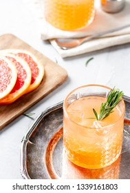 Cocktail with grapefruit juice and rosemary
