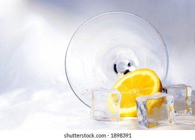 Cocktail with ice and lemon on its side
