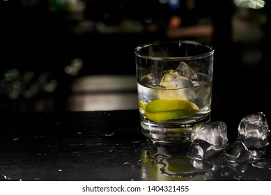 cocktail with ice and lime