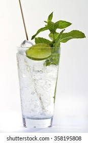 cocktail with lemon and mint leaves. healthy drink on white background. healthy juicing