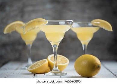 cocktail with lemon on a wooden background