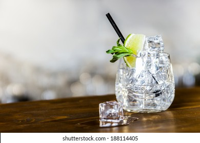 cocktail with lime, mint and ice