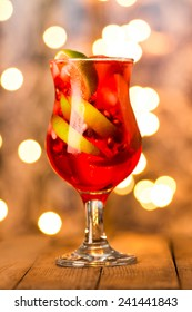Cocktail with lime and pomegranate