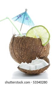 Cocktail made of cracked coconut against white background