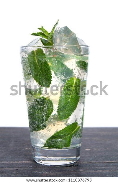 Cocktail with mint and crushed ice isolated on a white background