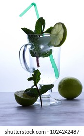 Cocktail with mint and lime, mojito, soft drink pop art, transparent cocktail with lemon, festive drink, copy space, healthy lifestyle, toned