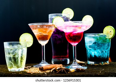 Cocktail mixologist on wood table and drinks background