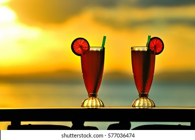 Cocktail near the beach during sunset,Outdoor table of a beach restaurant , shallow dept of field