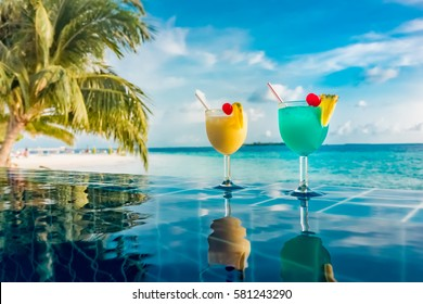 Cocktail near the swimming pool on the background of the Indian Ocean, Maldives.