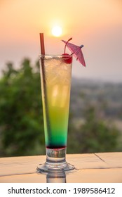 Cocktail near the swimming pool at sunset in Thailand