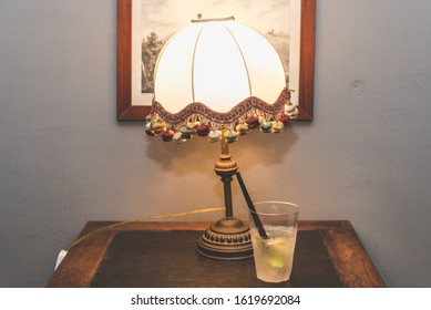 Cocktail near a vintage lamp