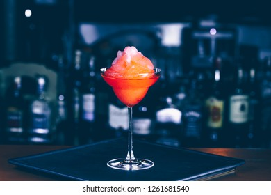 Cocktail at a nightclub. Nightlife and entertainment concept. Horizontal, moody blue toning