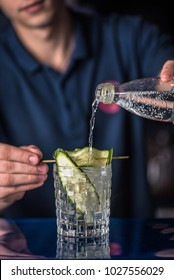 Cocktail on the bar. Preparation of summer drink. Fresh fruit drink.