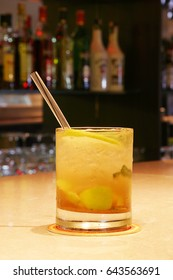 Cocktail on a bar table with cane