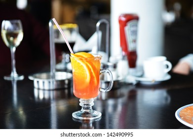 Cocktail with orange juice and ice cubes