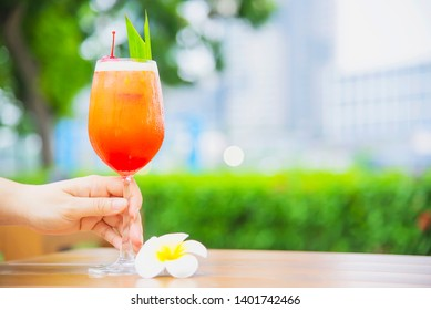 Cocktail recipe name mai tai or mai thai worldwide favour cocktail include rum lime juice orgeat syrup and orange liqueur - sweet alcohol drink with flower in garden relax vacation concept
