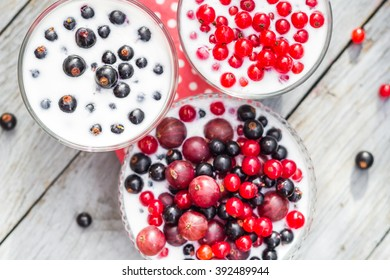 Cocktail of red fruits black currant on the table in the garden