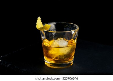 Cocktail RUSTY NAIL on black background
