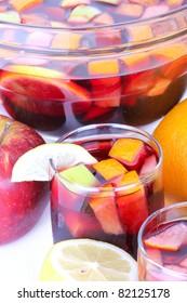 Cocktail sangria in glass bowl, closeup