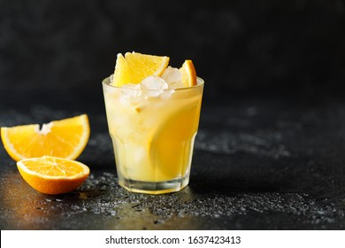 Cocktail screwdriver. Homemade orange cocktail with mint and vodka. Rum with orange juice