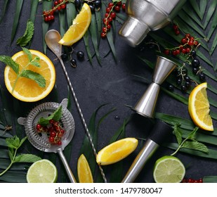 cocktail shaker on the background of fruits and tropical leaves