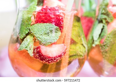 Cocktail with strawberries, mint and bubbles. Beverages background