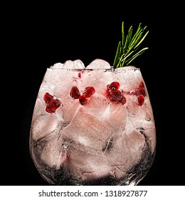 Cocktail suite on a black background. Alcoholic or non-alcoholic cocktail. Soda, vodka, ice and rosemary, pomegranate grains. Option Sea breeze cocktail