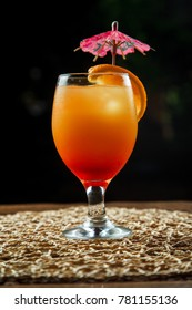 cocktail tequila sunrise in front of in front of black background