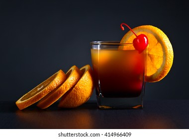 cocktail Tequila sunrise and orange on a dark background